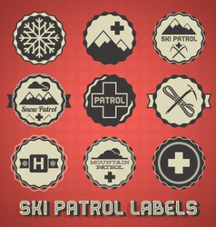 Vintage Ski Patrol Labels and Icons vector image