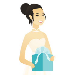 woman in a white bridal dress holding a gift box vector image