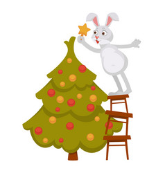 Funny bunny decorates christmas tree and stands vector