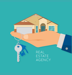 Hand holding house and key real estate agency vector