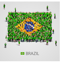 Large group people in brazil flag shape vector