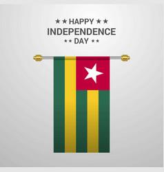 togo independence day hanging flag background vector image