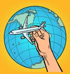 plane in hand metaphor flight to western vector image