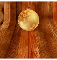 Gold bauble on rustic background EPS8 vector image vector image
