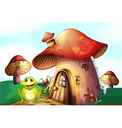 A frog beside a mushroom house vector image vector image