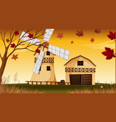 farm scene in nature with barn and windmill in vector image