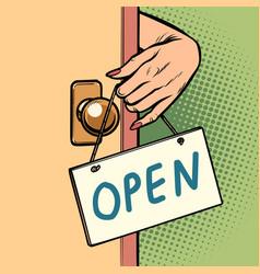 open woman hand hangs a sign on door vector image