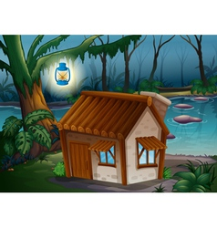 A house a lamp and a river vector image