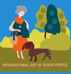 grandmother is walking in the park with her dog vector image