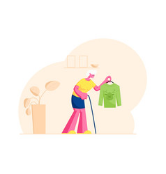 senior woman with walking cane holding hanger vector image