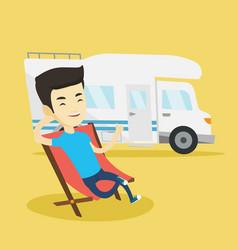 man sitting in chair in front of camper van vector image vector image