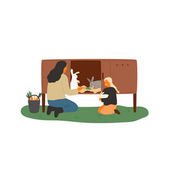 mother and daughter feeding rabbits in cell vector image