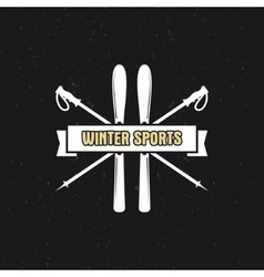 Winter sports label with ski equipment and ribbon vector