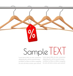 Coat hangers on a clothes rail Discount promotion vector image vector image