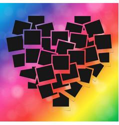 Heart concept made with empty photos on rainbow vector