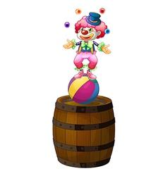 A clown juggling above barrel vector