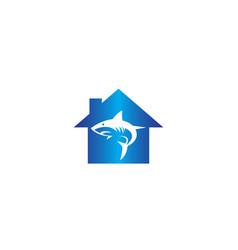 Angry blue shark fish logo design i a home shape vector