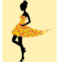 Dancer girl in dress of autumn leaves vector image