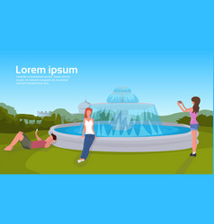 people relaxation photographing city park fountain vector image