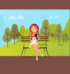stylish woman sitting in park and using tablet vector image