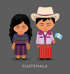 guatemalans in national dress with a flag vector image