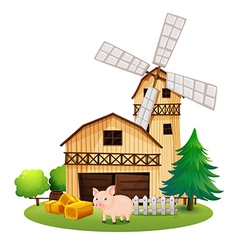 A pig in front of the farmhouse with windmill vector