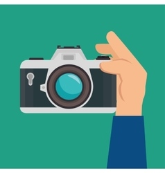 Hand hold retro camera green background design vector