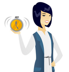 Young asian business woman holding alarm clock vector