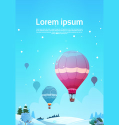 colorful air balloons flying in sky over winter vector image
