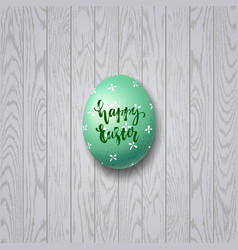 colorful easter egg on white wooden background vector image