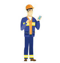 asian builder holding a mobile phone vector image vector image