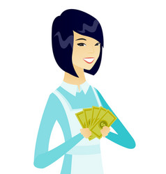 Young asian cleaner holding money vector