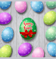 Colorful eggs with calligraphy happy easter vector