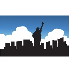 Silhouette of statue liberty blue sky vector