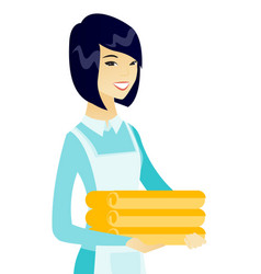 young asian housekeeping maid with stack of linen vector image