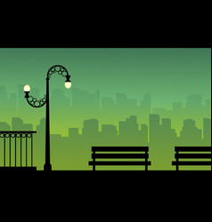 Silhouette of town background with street lamp vector