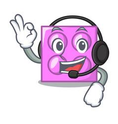 With headphone toy brick mascot cartoon vector