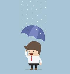 businessman holding an umbrella under the rain vector image