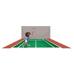 A boy playing tennis at the court vector image