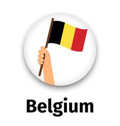 belgium flag in hand round icon vector image