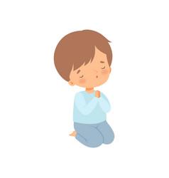 Sweet little boy kneeling and praying cartoon vector