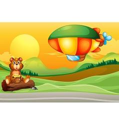 A bear near the road and an airship vector image vector image