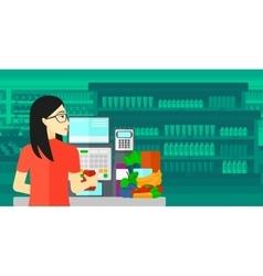 Cashier at supermarket checkout vector image