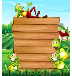 Wooden board and frogs in the field vector