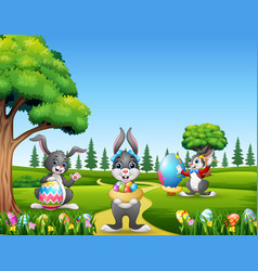 happy easter bunnies holding and painting eggs vector image