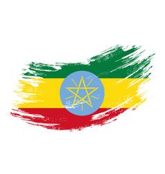 Ethiopian flag grunge brush background vector