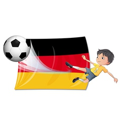 A boy playing football vector image