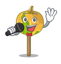 Singing candy apple mascot cartoon vector