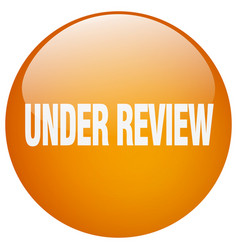 Under review orange round gel isolated push button vector