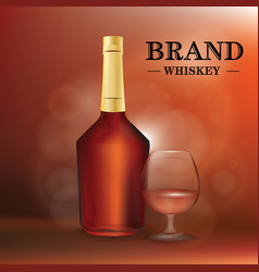 A bottle of cognac or whiskey and a glass vector